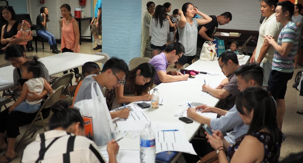 Donors filling out forms on tables